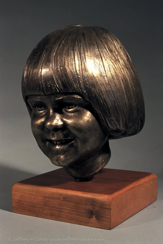 Bronze portrait of a young girl.