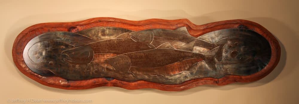 Three salmon rest in the shallow headwaters of a northern stream bed. Engraved steel metal wall art