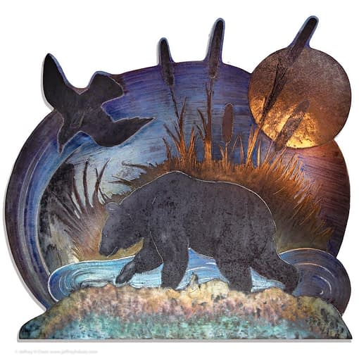 Metal wall art steel engraving of brown bear ambling beside a pond with tall cattails, the moon and a raven above.