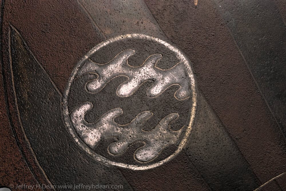 Engraved steel sawblade of blacksmith in the forge.