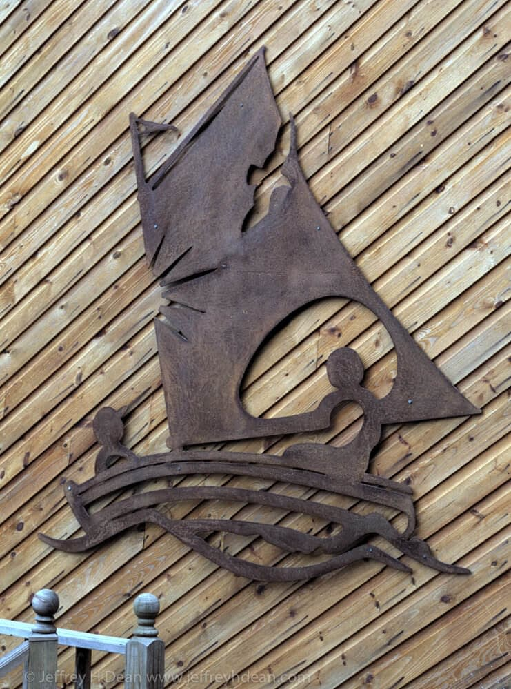 Sailing in the summer sun with a seagull and fish. Pierced steel metal wall art  sillohette.