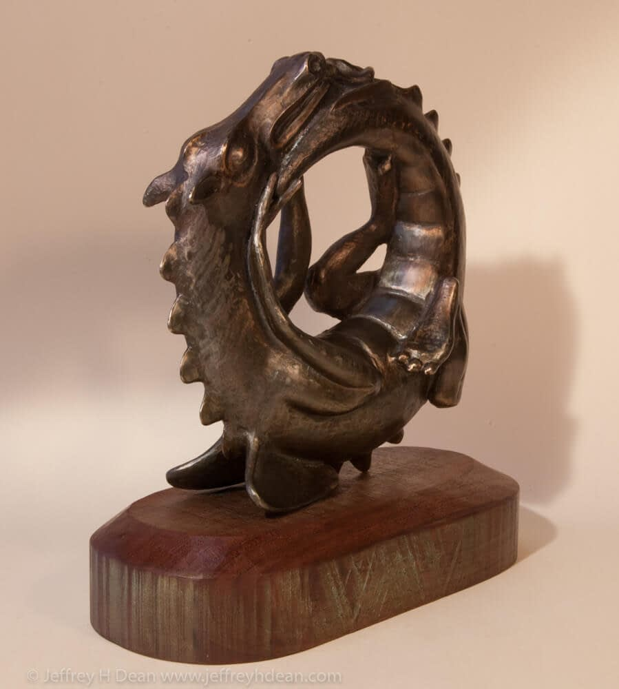 Sleeping baby dragon in bronze.