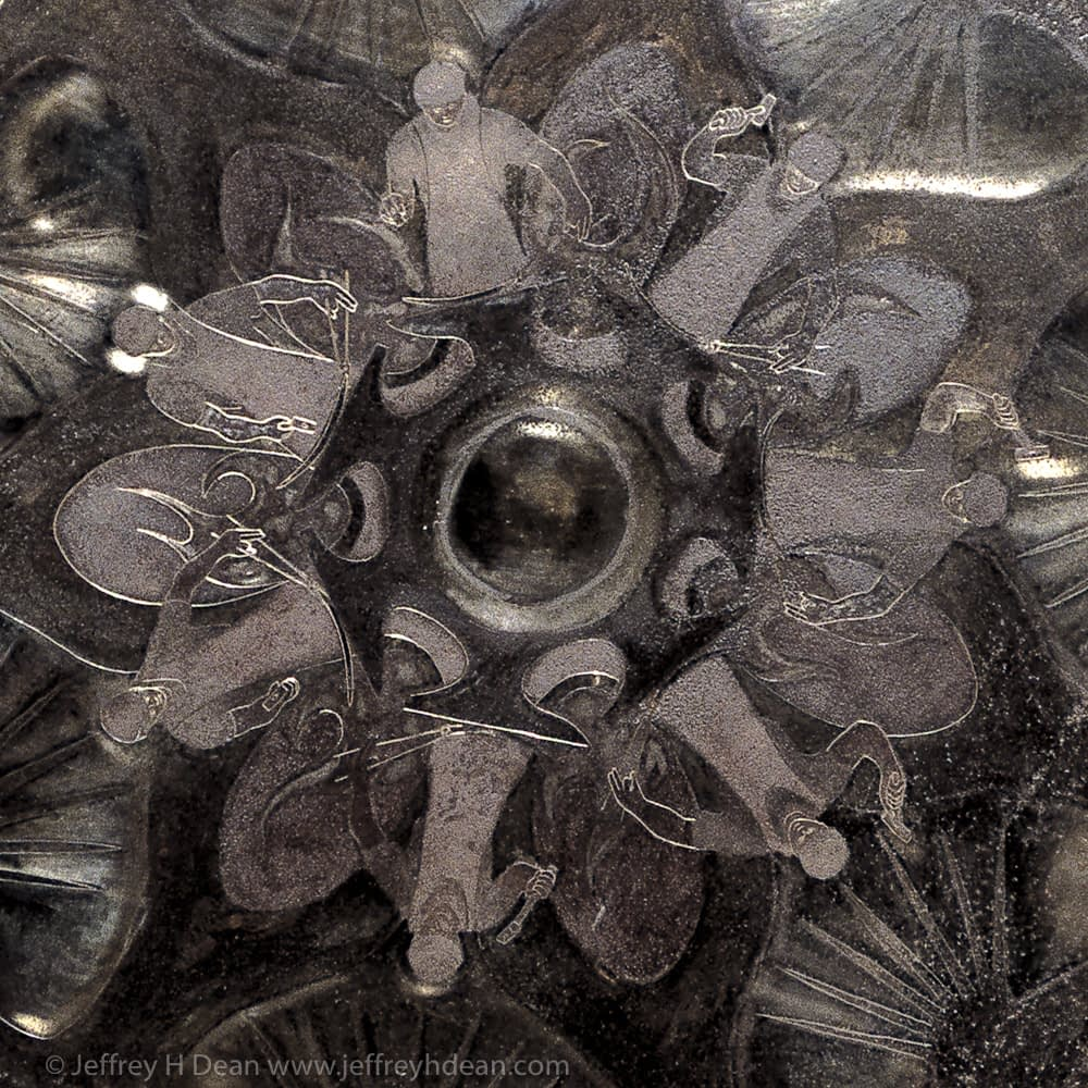 Saw blade metal wall art. The animated cycle of a hammer blow. A blacksmith hammering in the forge.  Engraved steel sawblades with heat tints.