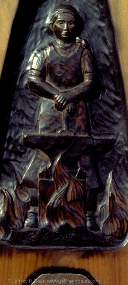 Black walnut relief carving of blacksmith with poem.