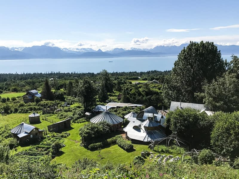 View from the hill behind Dean Family Farm and Art Studios overlooking Kachemak Bay and the Kenail Mountains.