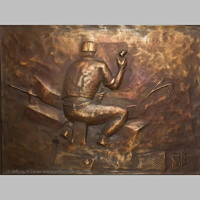 Bronze relief of Italian flagstone carver in Florence, Italy.