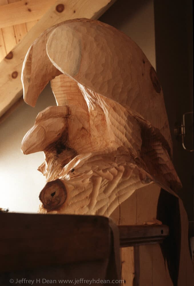 Carved golden eagle finial for structural timber in log house.